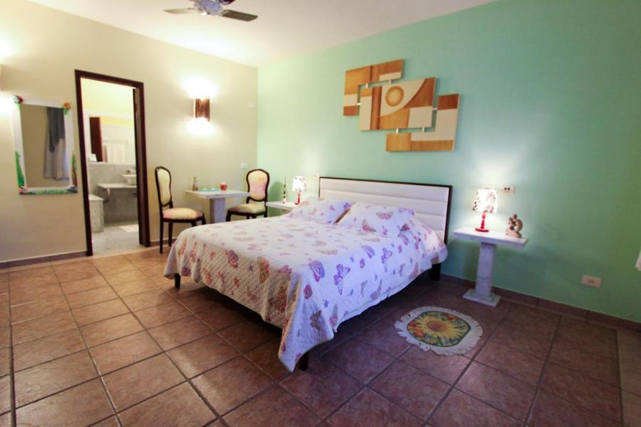Cama ou camas em um quarto em Pousada Vivenda do Flamboyant