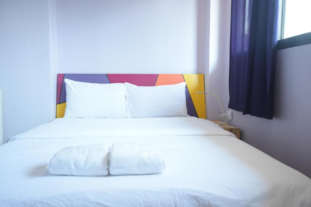 A bed or beds in a room at Room@Vipa