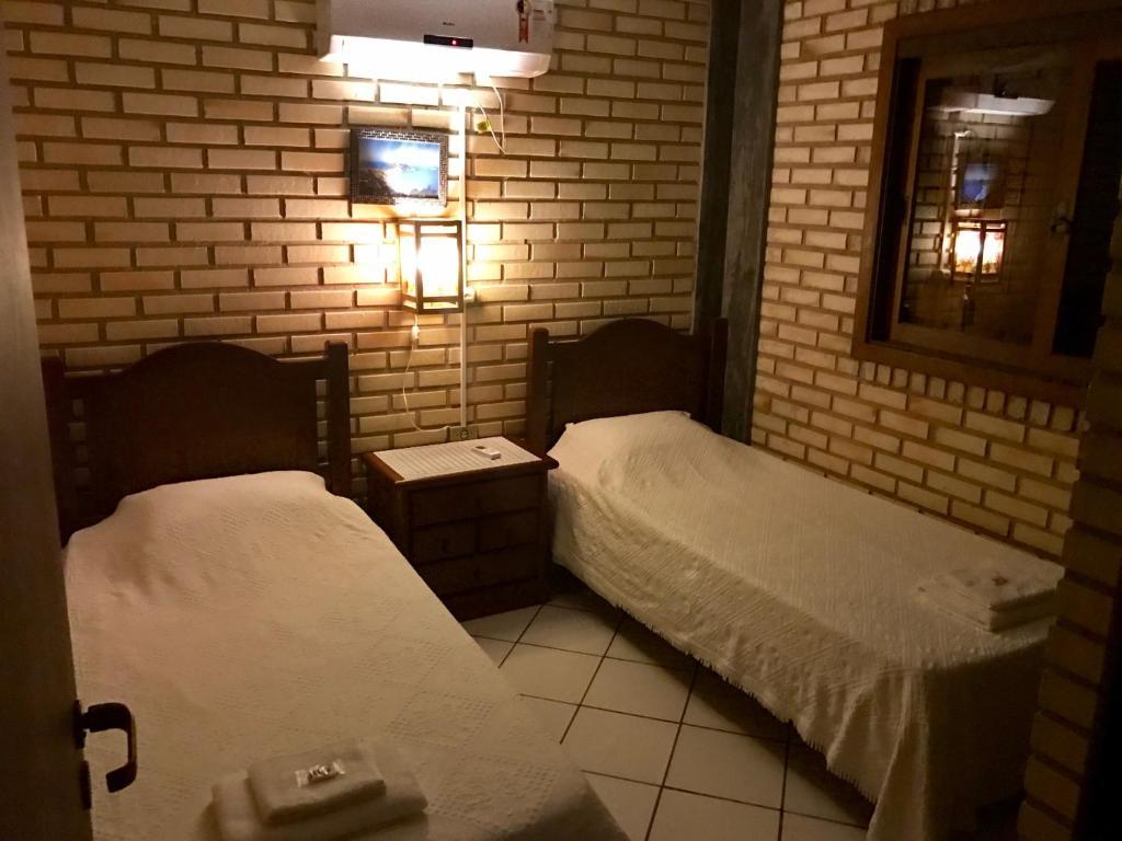 Cama o camas de una habitación en Jurerê Ville