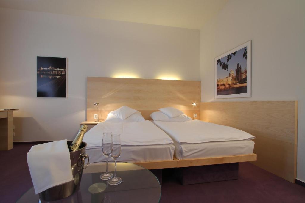 Ein Bett oder Betten in einem Zimmer der Unterkunft Hotel DAP