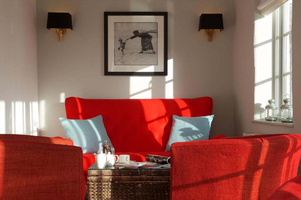 A seating area at Lugger Hotel 'A Bespoke Hotel'