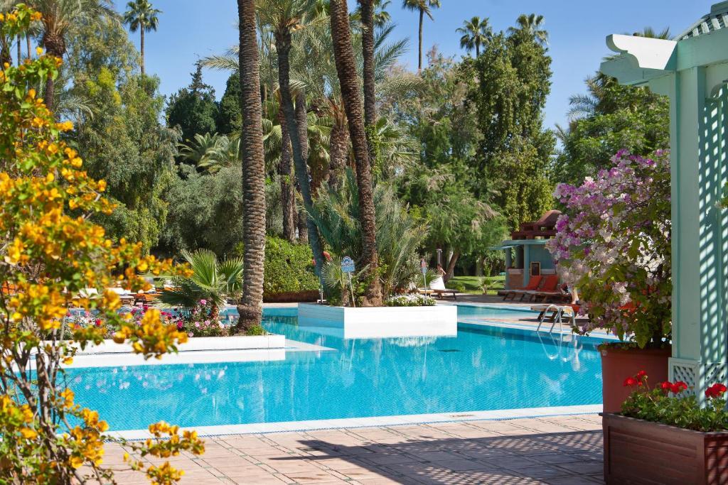 The swimming pool at or near Kenzi Rose Garden