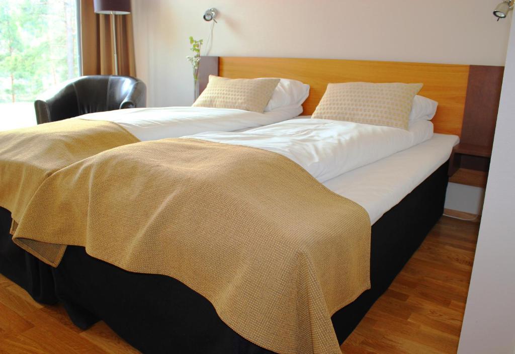 En eller flere senger på et rom på Heimat Brokelandsheia