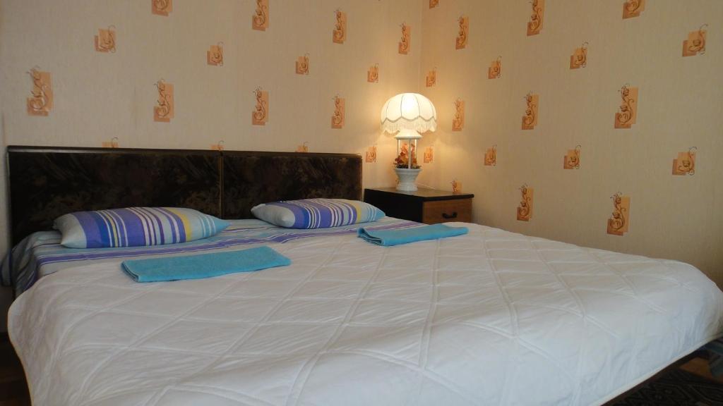 Кровать или кровати в номере Apartment First