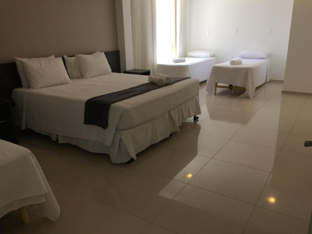 A bed or beds in a room at Scenarium Hotel