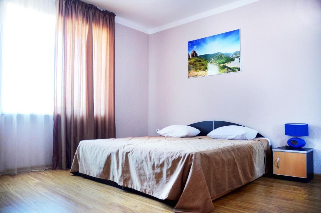 Кровать или кровати в номере Autopapa
