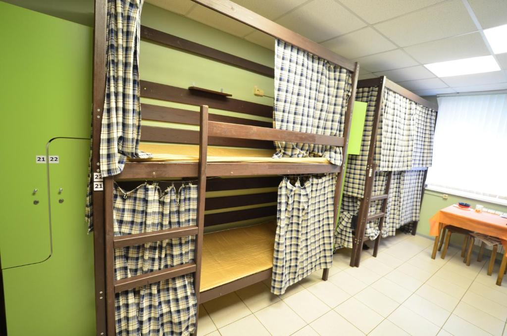 A bunk bed or bunk beds in a room at Hostel Tovarisch