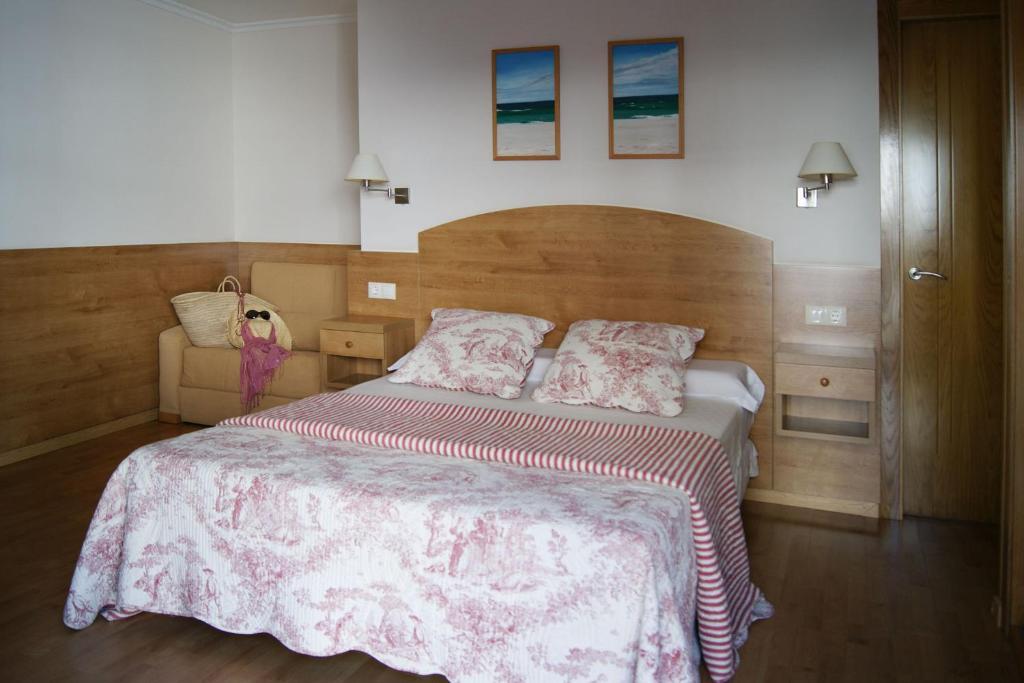 Cama o camas de una habitación en Hostal Casa Isabel