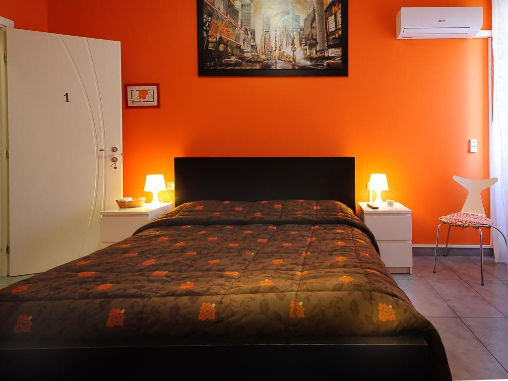 A bed or beds in a room at Adriatic Room I