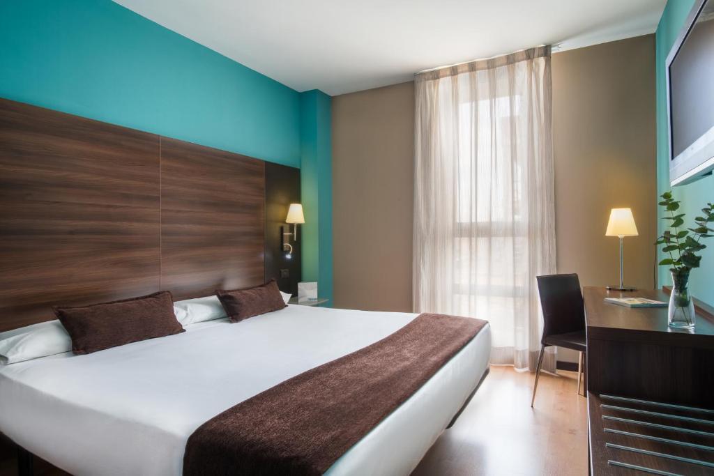 Letto o letti in una camera di Eurostars Rey Fernando
