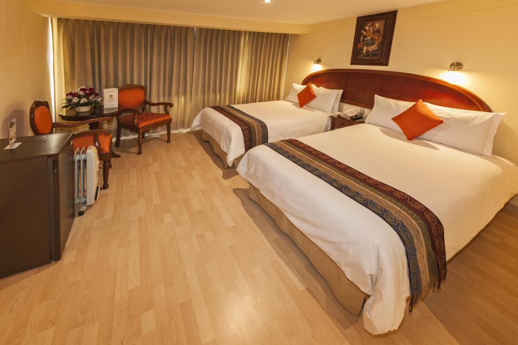 Un ou plusieurs lits dans un hébergement de l'établissement Agustos Cusco