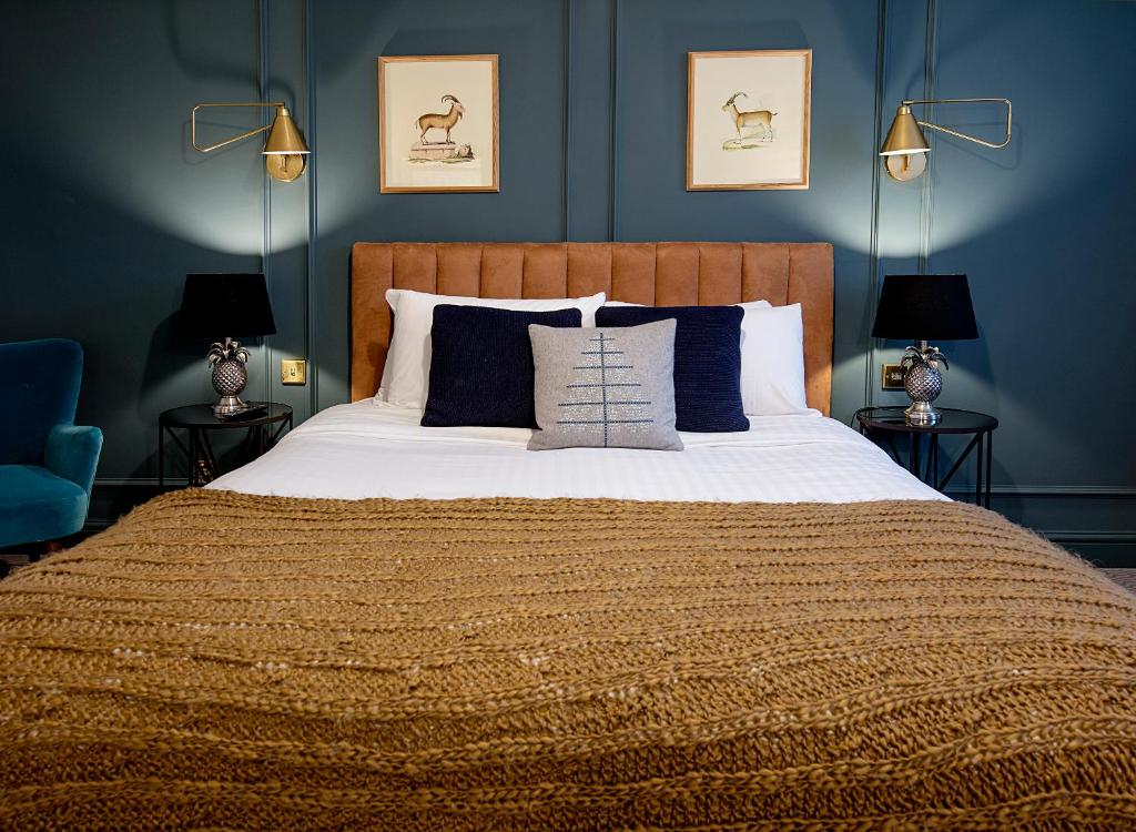 A bed or beds in a room at Cromwell Hotel Stevenage