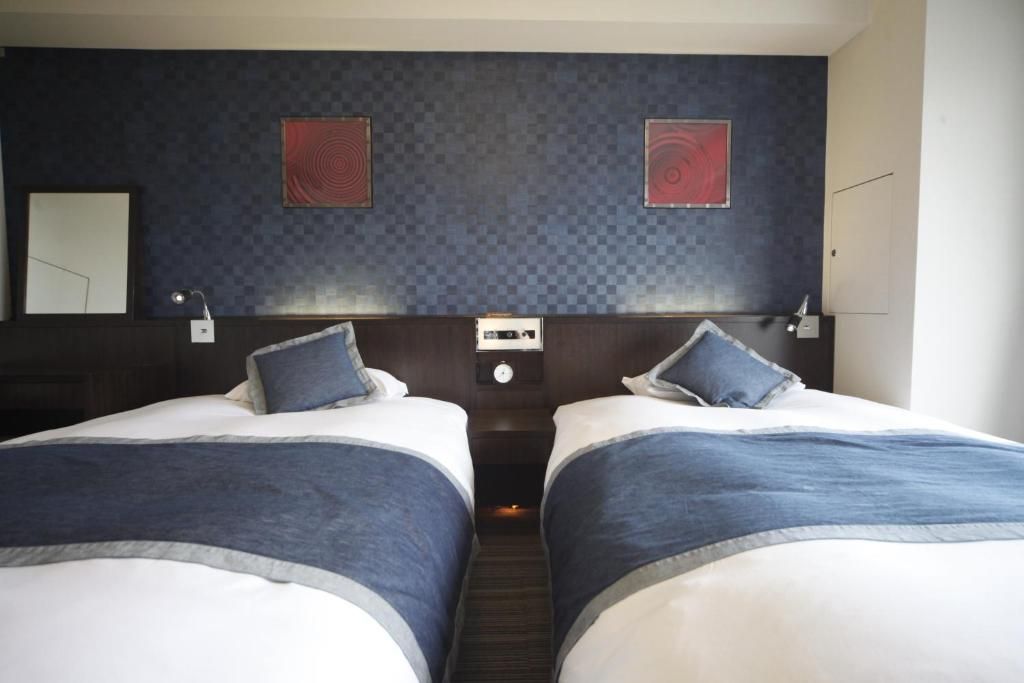 A bed or beds in a room at Via Inn Asakusa