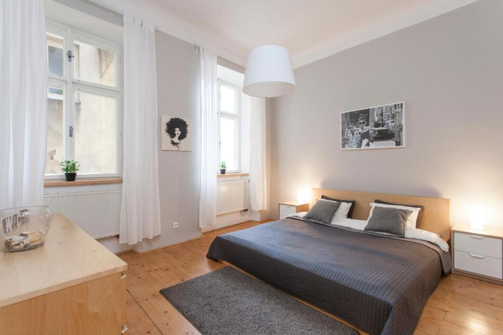 A bed or beds in a room at Zuzana Apartment