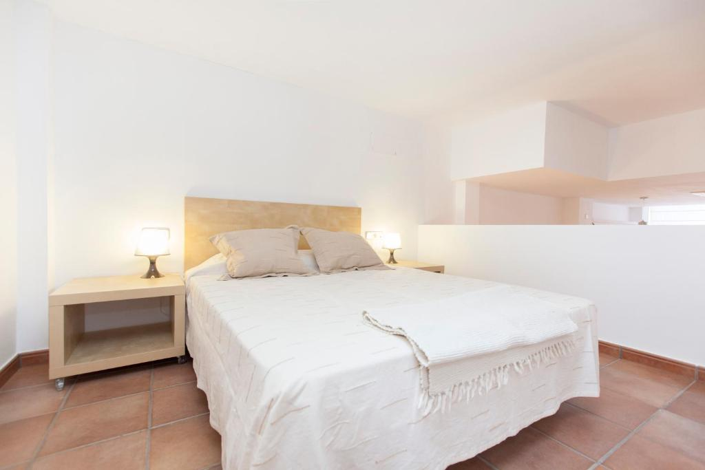 A bed or beds in a room at Stay Barcelona Vila de Gracia