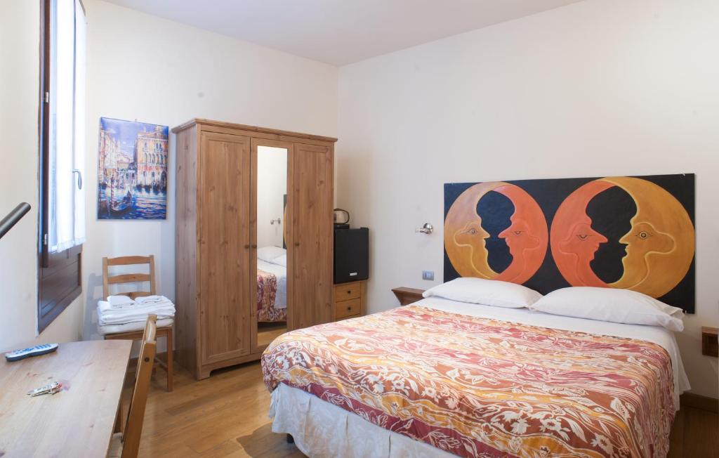 A bed or beds in a room at Ai Tagliapietra