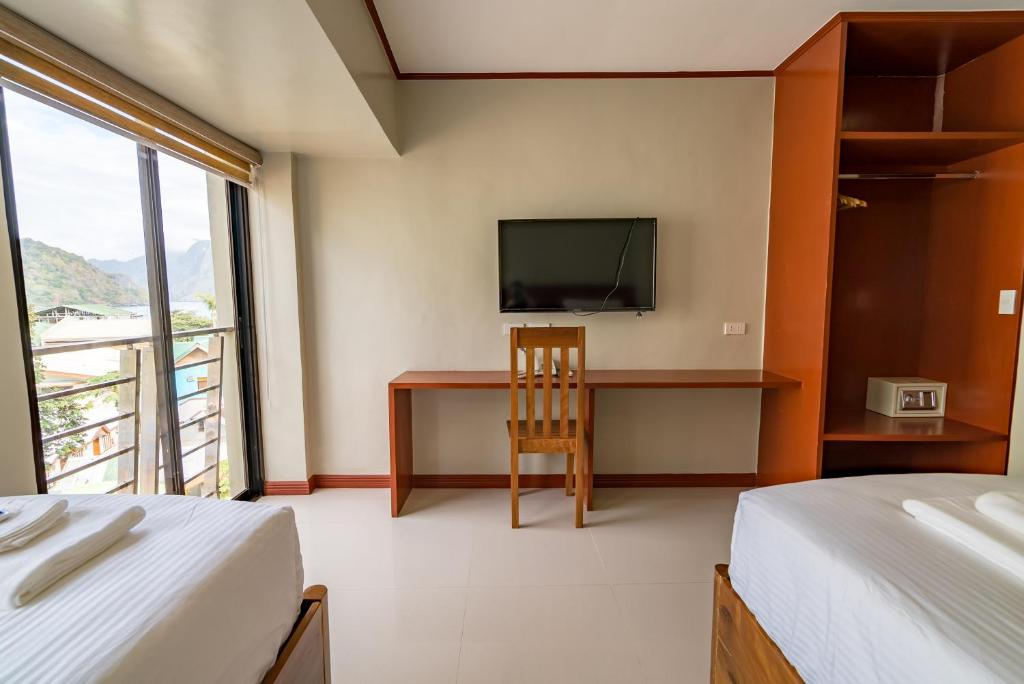 A bed or beds in a room at Coral Cliff Hotel
