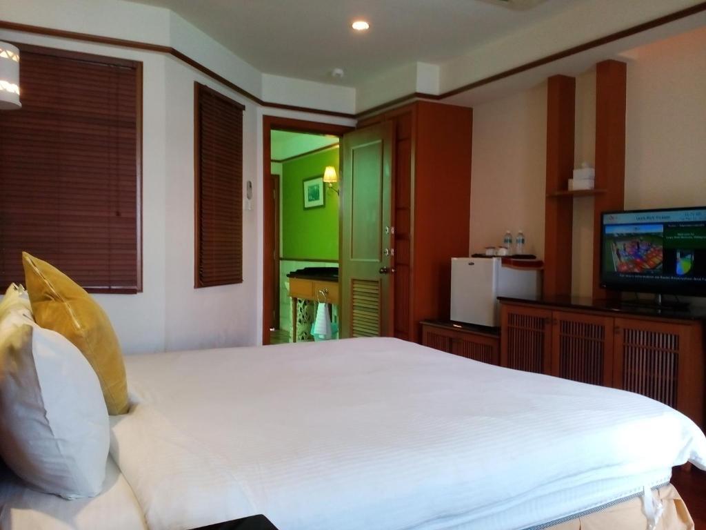 Cama o camas de una habitación en Wonderland Private Chalet at Port Dickson