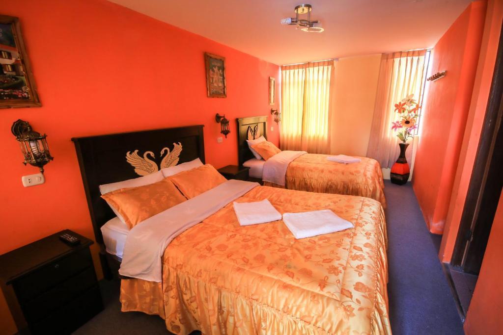Un ou plusieurs lits dans un hébergement de l'établissement Rumi Wasi