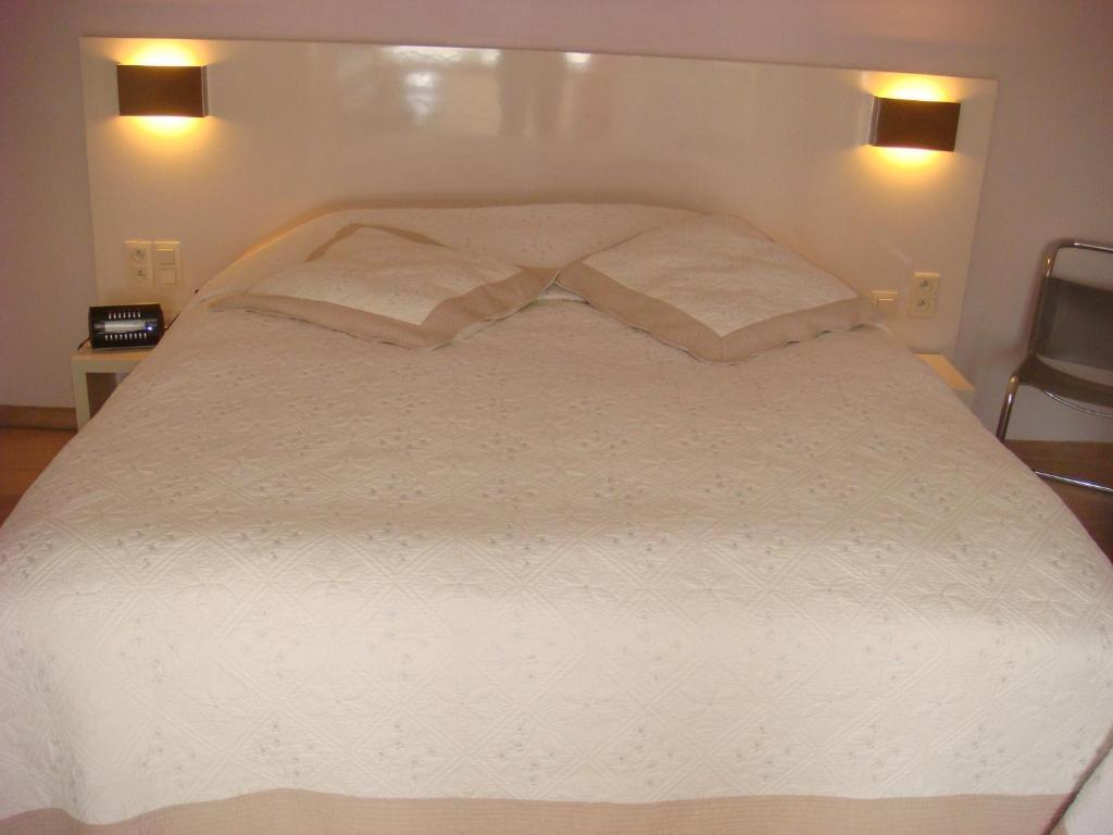 Een bed of bedden in een kamer bij B&B Centersuites