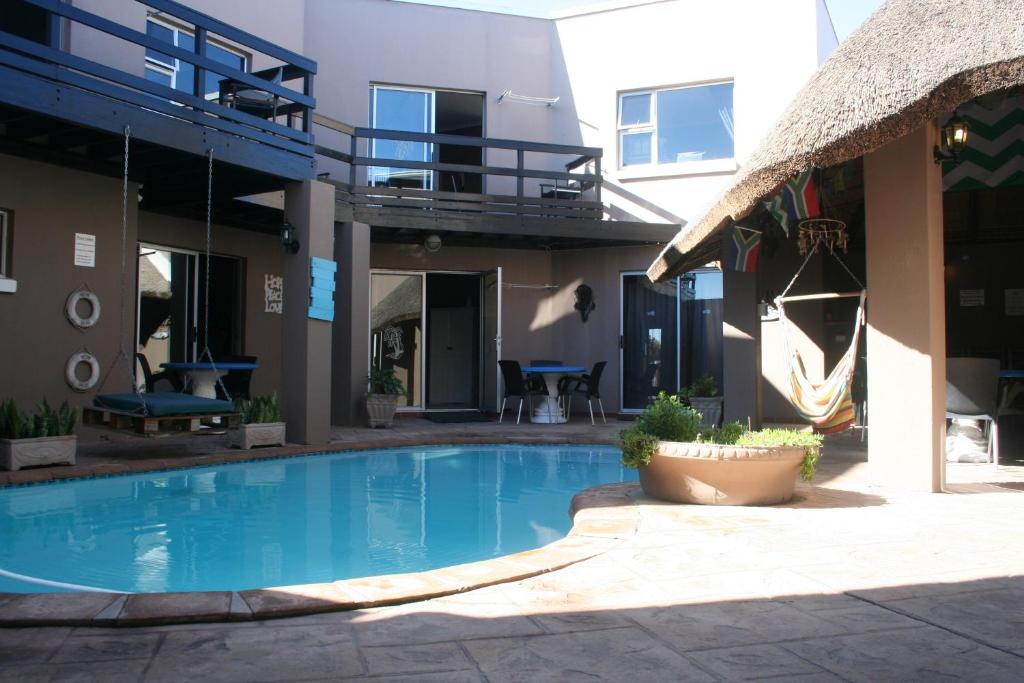 The swimming pool at or near Colors of Cape Town Lodge