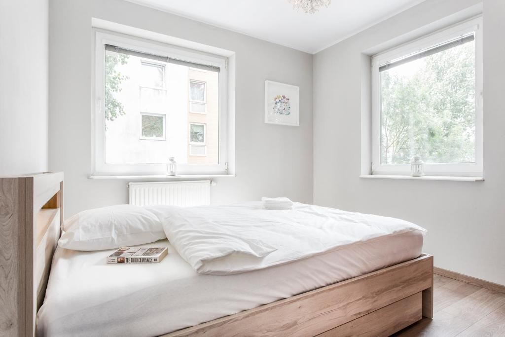 A bed or beds in a room at Warm Street Apartment - Peace and Comfort