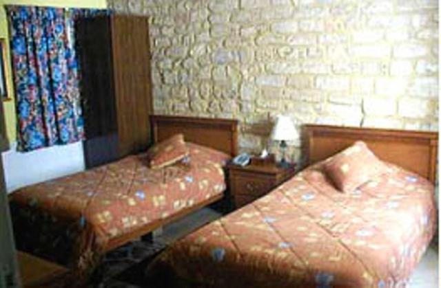 A bed or beds in a room at Yacoub Hotel