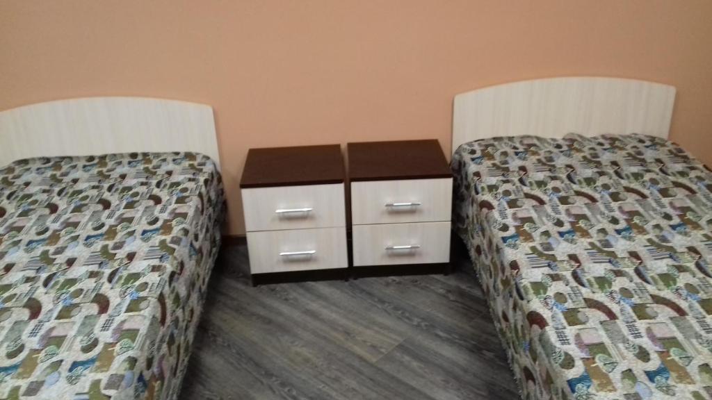 Кровать или кровати в номере Хостел Корона