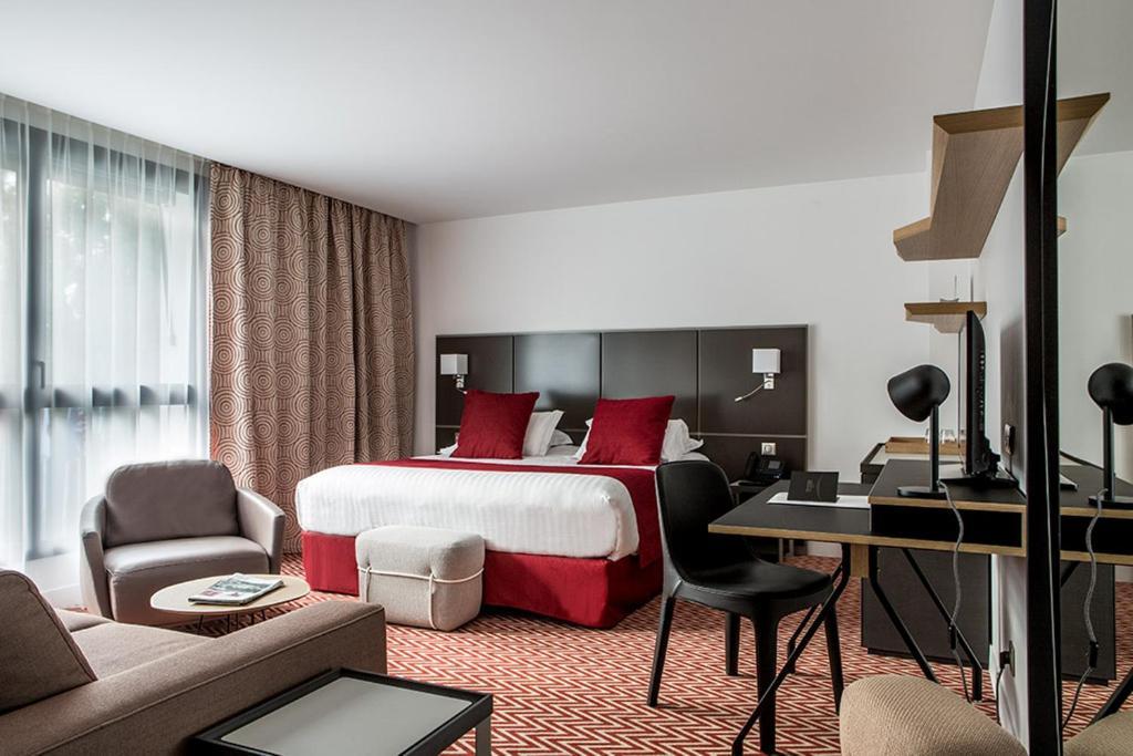 Un ou plusieurs lits dans un hébergement de l'établissement Forest Hill Meudon Velizy