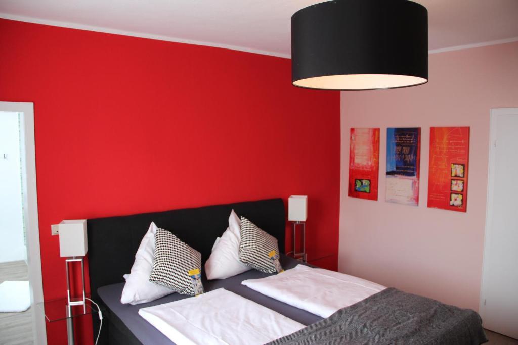 Ein Bett oder Betten in einem Zimmer der Unterkunft Hotel-Lahngarten Marburg
