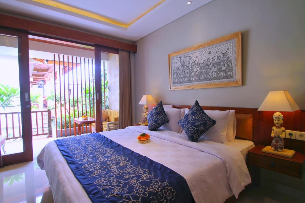 A bed or beds in a room at Narada House Ubud