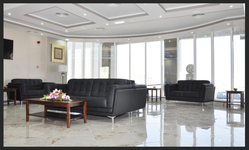 The lobby or reception area at Muscat Hills Hotel