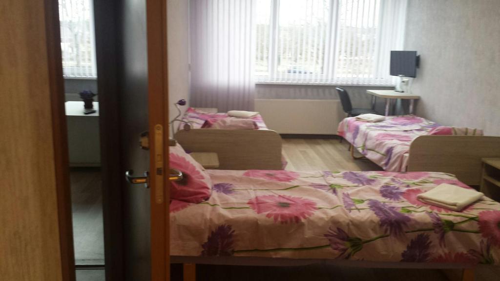 A bed or beds in a room at LLKC Hostel
