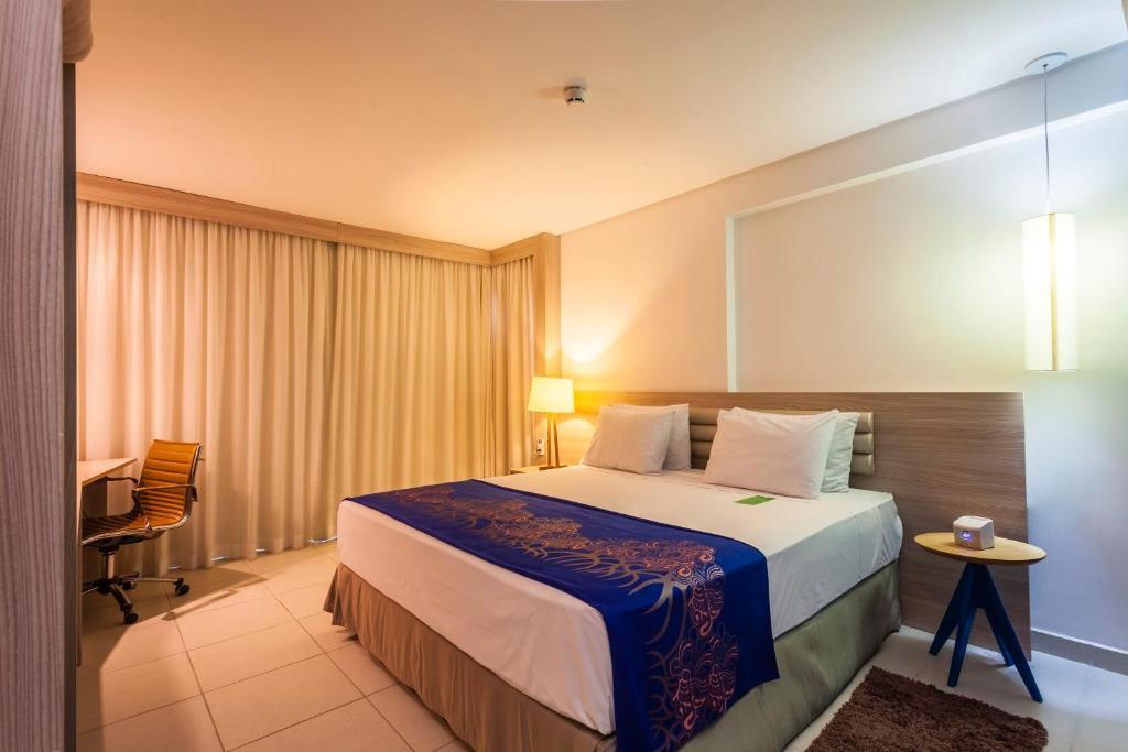 Cama ou camas em um quarto em Bristol Recife Hotel & Convention