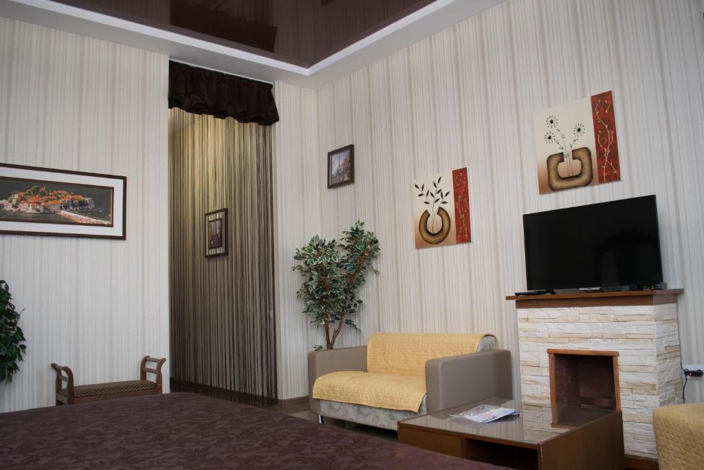 A television and/or entertainment center at Leon Hotel