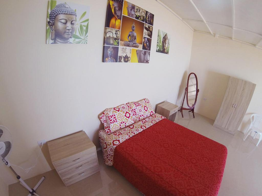 A bed or beds in a room at Tiny Hostel Atacama