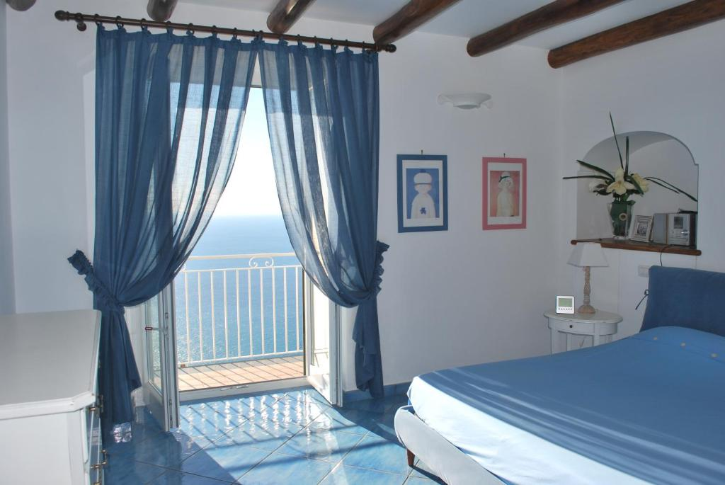 A bed or beds in a room at Villa Annu'