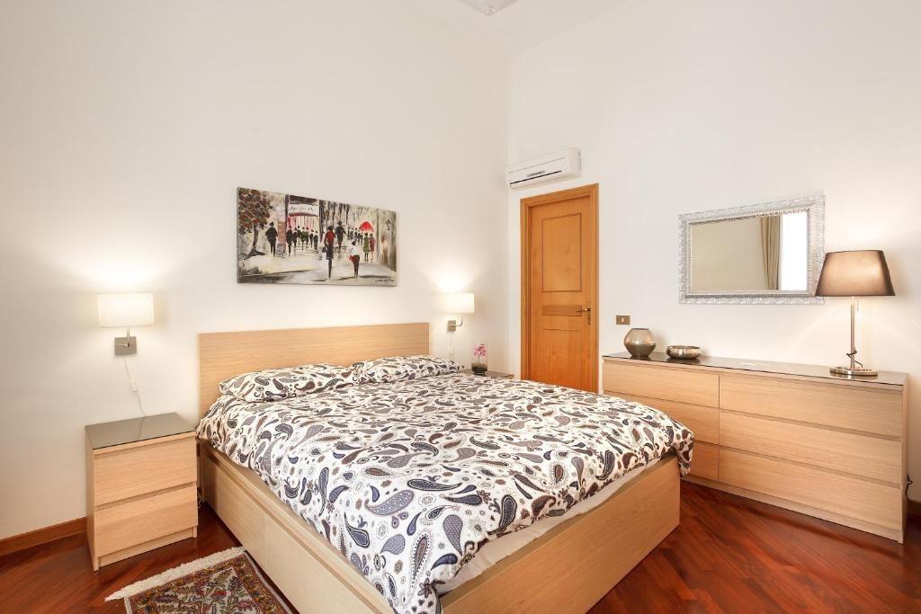 A bed or beds in a room at Casa Mazzini34