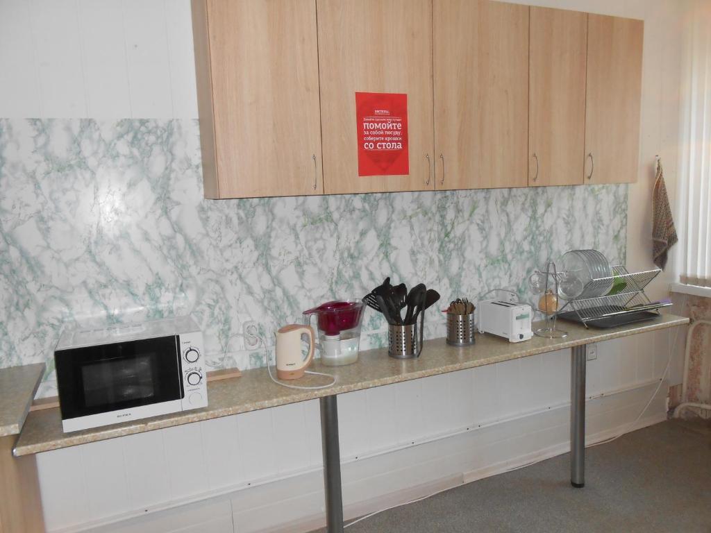 Кухня или мини-кухня в Hostel Kak Doma