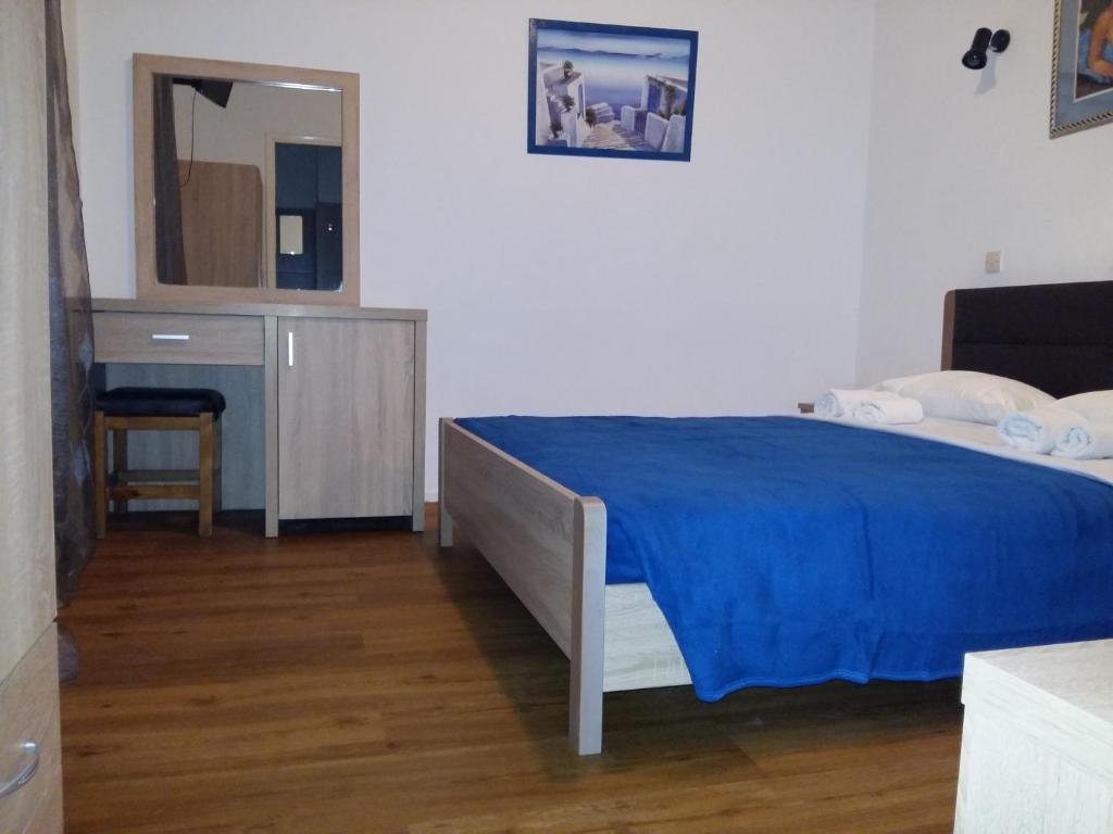 Łóżko lub łóżka w pokoju w obiekcie Sparta Team Hotel
