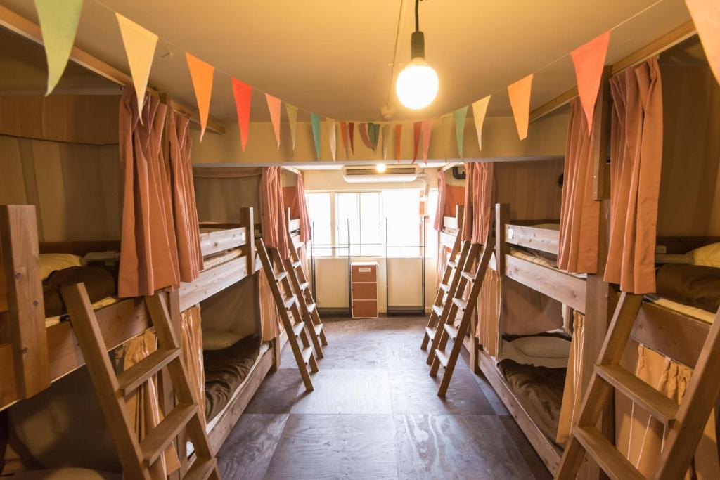 A bunk bed or bunk beds in a room at Hostel Q