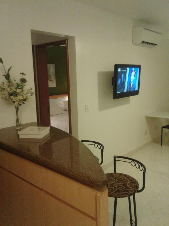 A television and/or entertainment center at Apart Quartier Latin Hotel