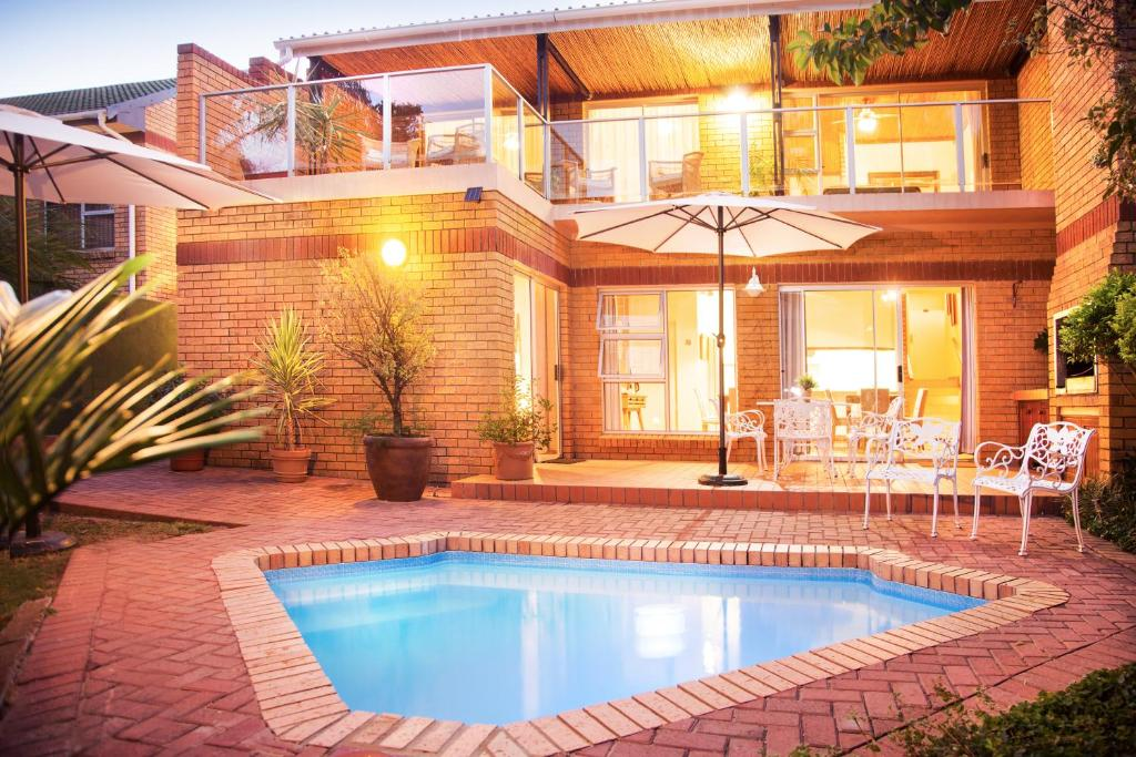 The swimming pool at or near Feather Nest Guest House