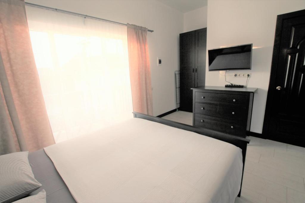 Кровать или кровати в номере Гостевой дом Азов Инн