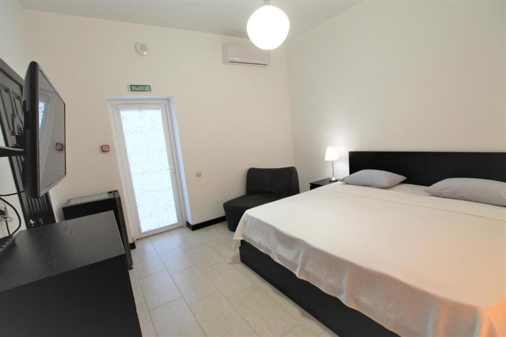 A bed or beds in a room at Guest House Azov Inn