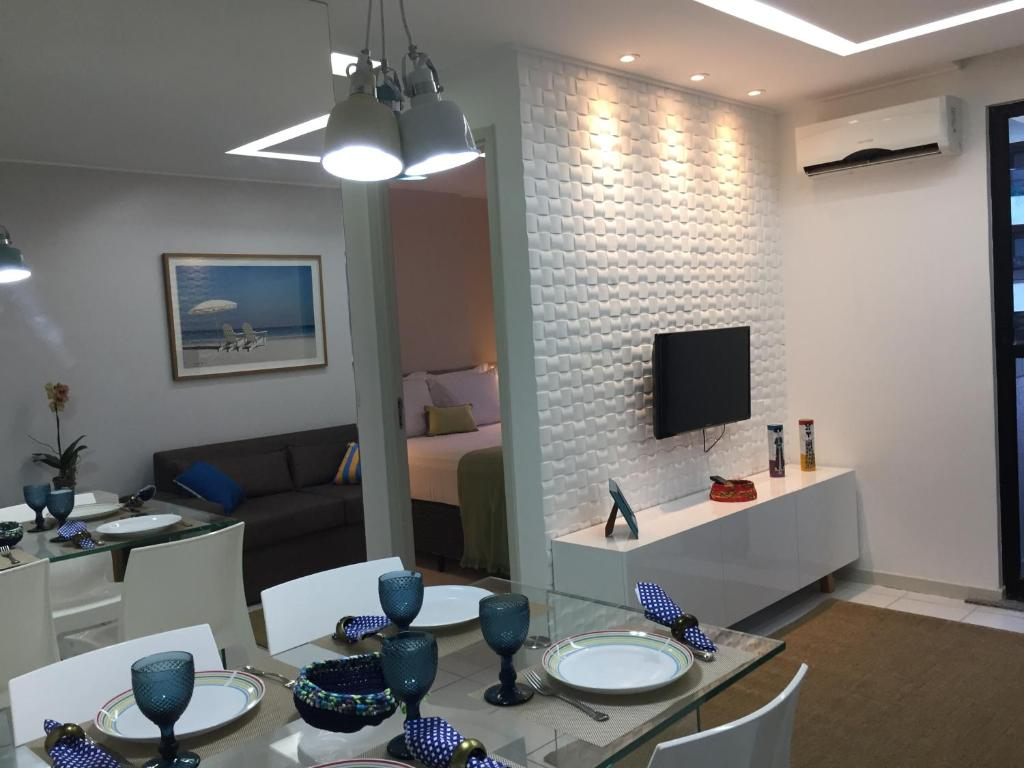 Een TV en/of entertainmentcenter bij Neo 1 - Apto 603 - Beira Mar Pajuçara