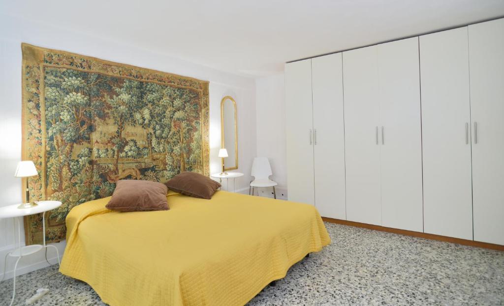 Łóżko lub łóżka w pokoju w obiekcie Apartment Calle del Forno