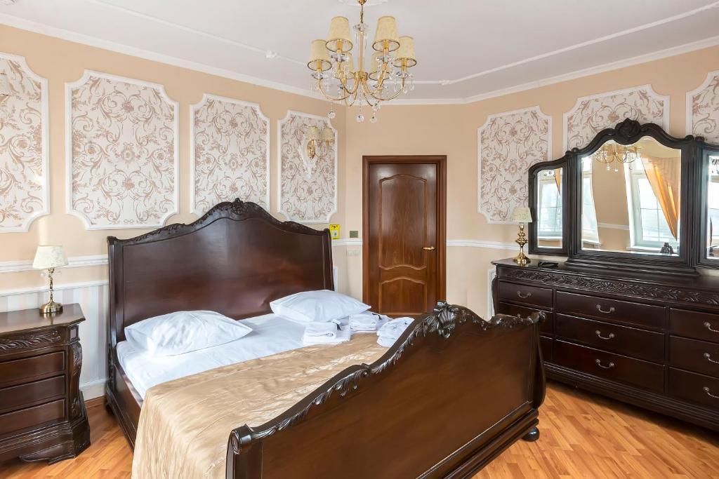 Кровать или кровати в номере Принцесса Элиза Отель