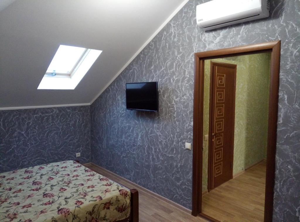 Телевизор и/или развлекательный центр в Гостевой дом на Видная 26