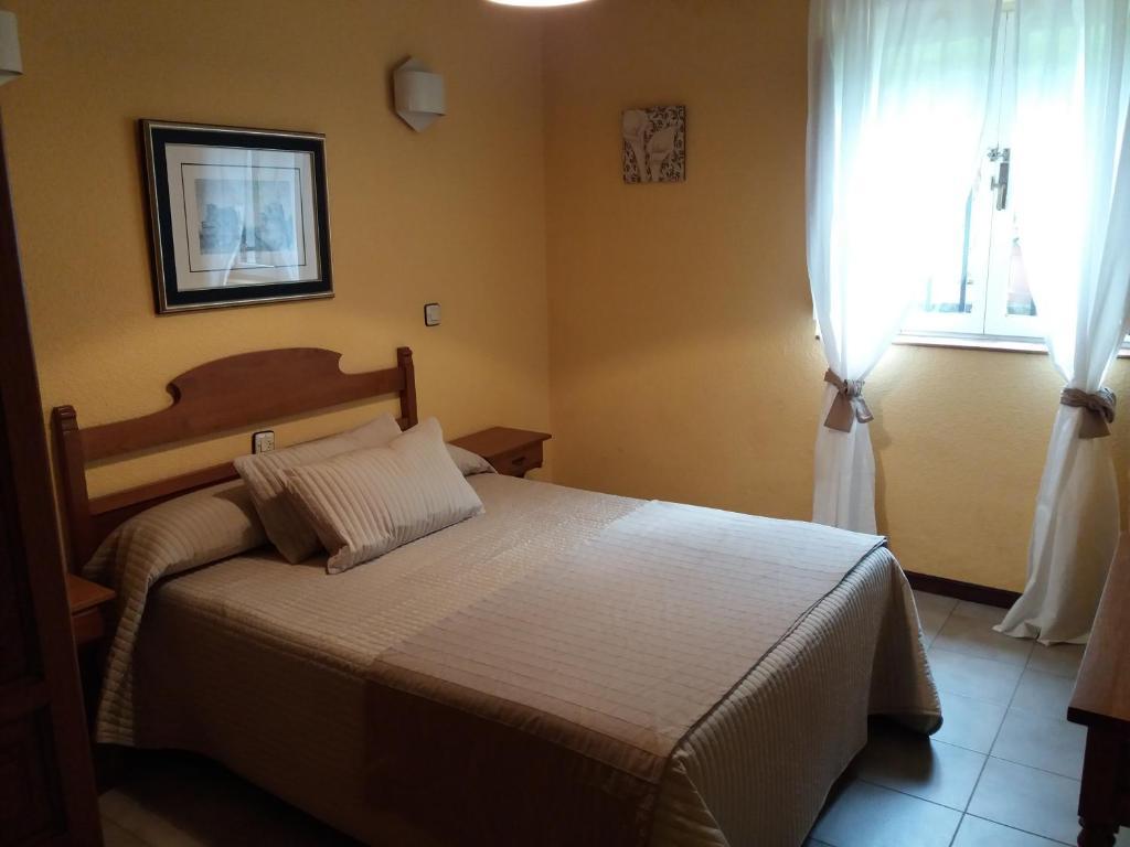 Un ou plusieurs lits dans un hébergement de l'établissement Hostería El Cruce